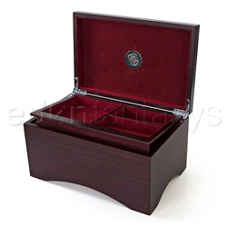 A wooden jewelry box with hidden sex toy compartment and secret magnet key.